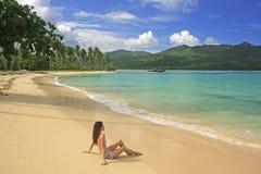 Young woman in bikini sitting at Rincon beach, Samana peninsula Royalty Free Stock Photos