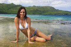 Young woman in bikini sitting at Rincon beach, Samana peninsula Royalty Free Stock Image