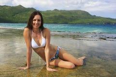 Young woman in bikini sitting at Rincon beach, Samana peninsula. Dominican Republic royalty free stock image