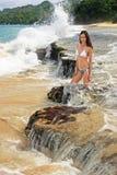 Young woman in bikini sitting on rocks at Rincon beach, Samana p Royalty Free Stock Image