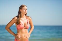 Young woman in bikini standing on beach Royalty Free Stock Image