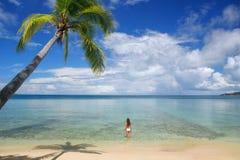 Young woman in bikini standing in clear water, Nananu-i-Ra islan Royalty Free Stock Images
