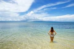 Young woman in bikini standing in clear water on Taveuni Island, Stock Photography