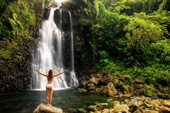 Young woman in bikini standing by Middle Tavoro Waterfalls in Bo Royalty Free Stock Photos