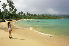 Young woman in bikini standing at Rincon beach, Samana peninsula Royalty Free Stock Images