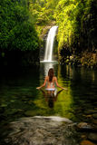 Young woman in bikini standing at Wainibau Waterfall on Taveuni Royalty Free Stock Images