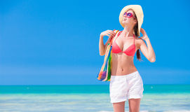 Young woman in bikini and sunglasses with beach Stock Photo