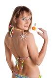 Young woman in bikini with sunscreen. Stock Image