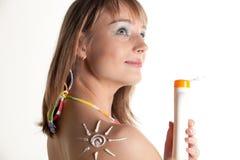 Young woman in bikini with sunscreen. Royalty Free Stock Photos