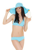 Young woman in bikini with sunscreen. Stock Images