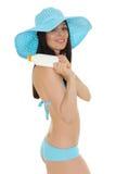 Young woman in bikini with sunscreen. Stock Photography
