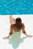 Young woman in bikini suntanning at the pool Royalty Free Stock Photo