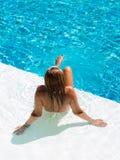 Young woman in bikini suntanning at the pool Stock Photo