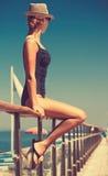 Young woman in bikini swimsuit and sun hat. Stock Photography