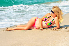 Young Woman in bikini swimwear sunbathing on the sandy Beach Seaside Stock Photos
