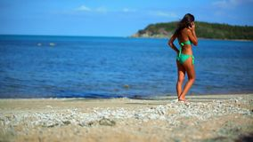 Young woman in bikini talking on her mobile, cell Royalty Free Stock Photo