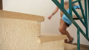 Young woman in bikini up stairs stock video footage