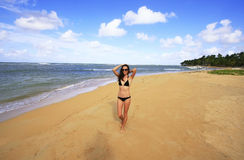 Young woman in bikini walking on Las Terrenas beach, Samana peni Royalty Free Stock Images