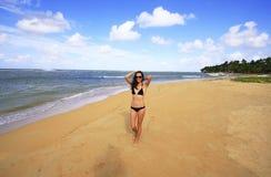 Young woman in bikini walking on Las Terrenas beach, Samana peni. Nsula, Dominican Republic Royalty Free Stock Images