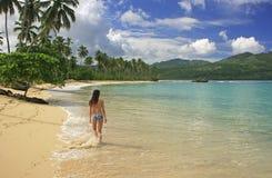 Young woman in bikini walking at Rincon beach, Samana peninsula. Dominican Republic stock photo
