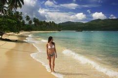 Young woman in bikini walking at Rincon beach, Samana peninsula. Dominican Republic Stock Images