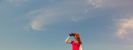 Young woman with binocular Royalty Free Stock Photography