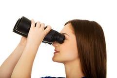 Young woman with binoculars. Stock Image
