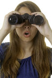 Young woman with binoculars Royalty Free Stock Image