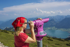 Young woman with binoculars in Dolomites, Italy Stock Photos
