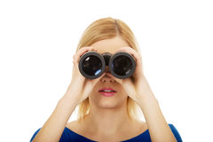 Young woman with binoculars. Royalty Free Stock Photo