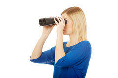 Young woman with binoculars. Stock Image