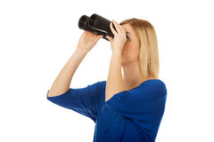 Young woman with binoculars. Stock Images