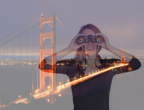 Young woman with binoculars near Golden Gate Bridge. Double expo Stock Photos