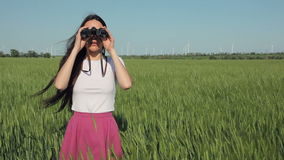 Young woman with binoculars stock footage