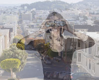 Young woman with binoculars in San Francisco. Double exposure po Stock Images
