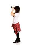 Young woman with binoculars. Stock Photos