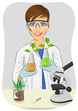 Young woman biologist in white coat holding two flasks with plants next to microscope in laboratory Stock Images