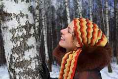 Young woman in birch wood in winter Royalty Free Stock Image