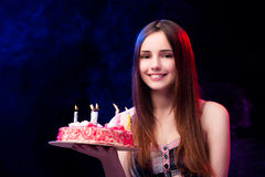 The young woman with birthday cake at party Royalty Free Stock Images