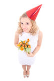 Young woman in birthday cap with flowers Stock Image