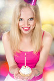 Young woman with birthday cupcake Stock Photos