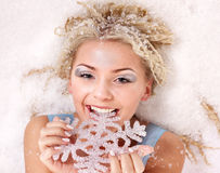 Young woman bite snowflake. Royalty Free Stock Photos