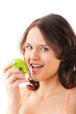 Young woman bites in a fresh and healthy apple Royalty Free Stock Photography