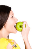 Young woman biting green apple Royalty Free Stock Photography