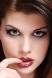 Young Woman Biting Her Finger Royalty Free Stock Images