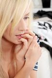Young woman biting nails Stock Photos