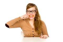 Young woman biting pen Royalty Free Stock Photography