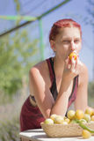 Young woman biting a plum Royalty Free Stock Images