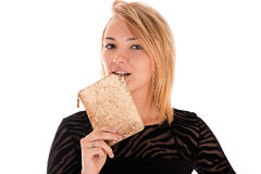 Young woman biting purse Royalty Free Stock Photography