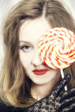 Young woman biting  sugar candy Stock Image